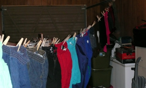 clothes hanging in garage
